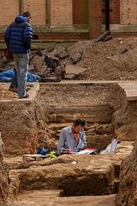 An archeologist working in a trench